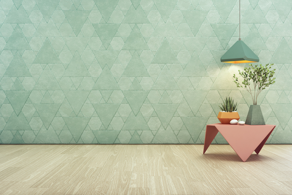 Indoor plant on pink steel coffee table and lamp with empty turquoise triangle pattern wall background, Relaxing area in pastel room of modern house.