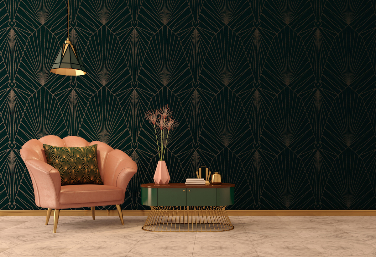 Art Deco interior in classic style with pink armchair and pillow.Vase on table.Dark green wall with ceiling lamp.