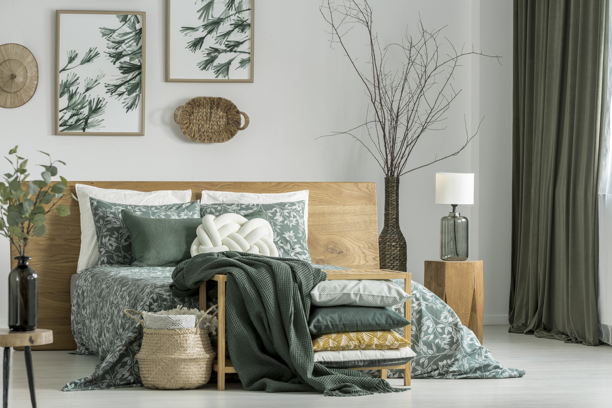 Khaki bedroom with wooden furniture