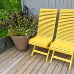 Yellow chairs and flowers decorating house exterior