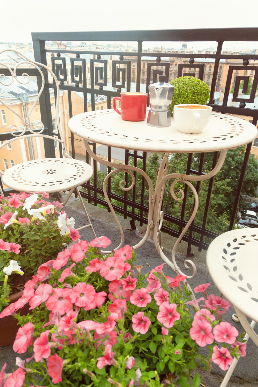 Coffee cups on table on romantic balcony
