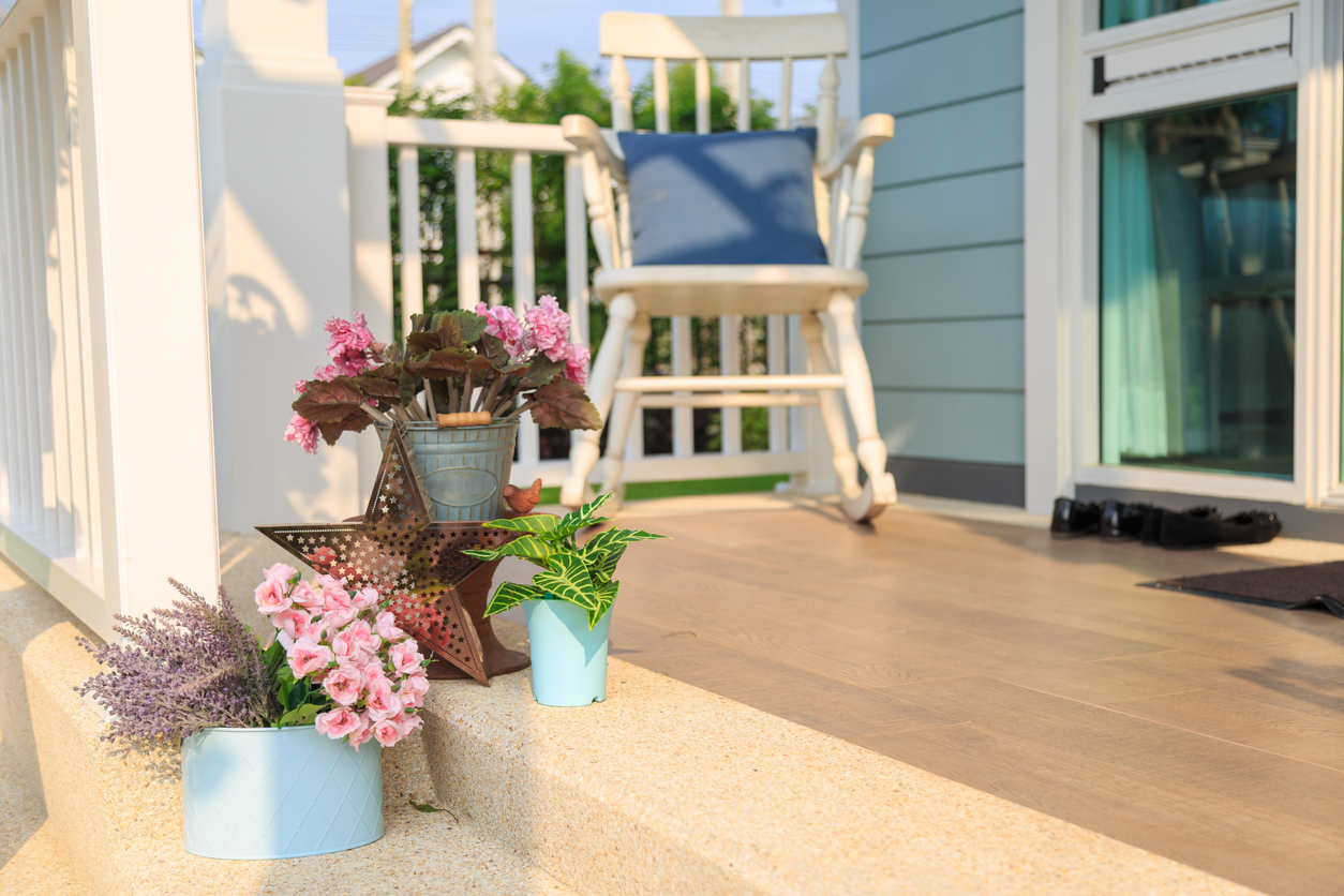 Flower bouquet on a floor with rocking chair background in a balcony