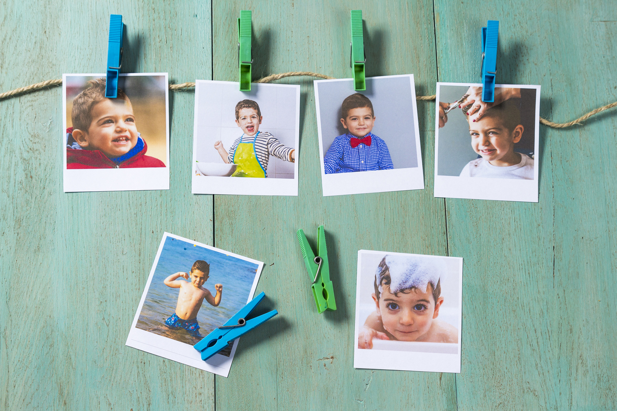 Child photographs hanging on a clothesline