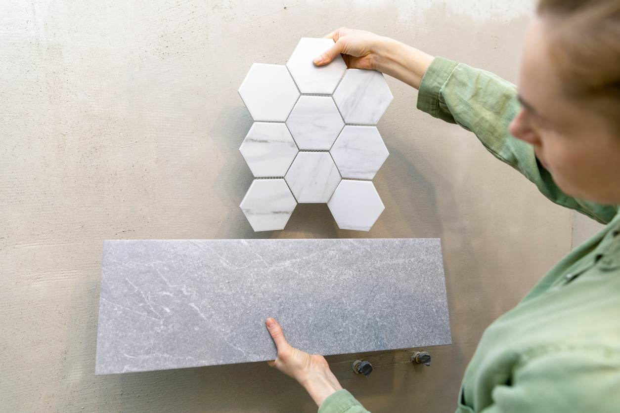Interior designer trying new tiles on the wall for bathroom interior design