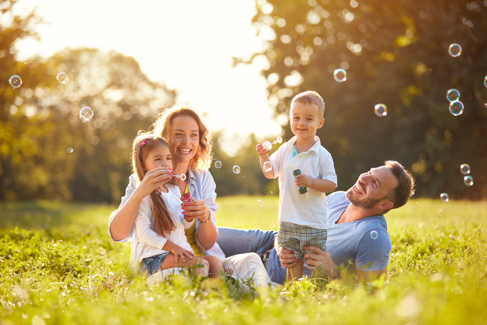 Family,With,Children,Blow,Soap,Bubbles,Outdoor